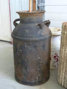 Rusty containers add country charm to Christmas planters. Just add greenery!